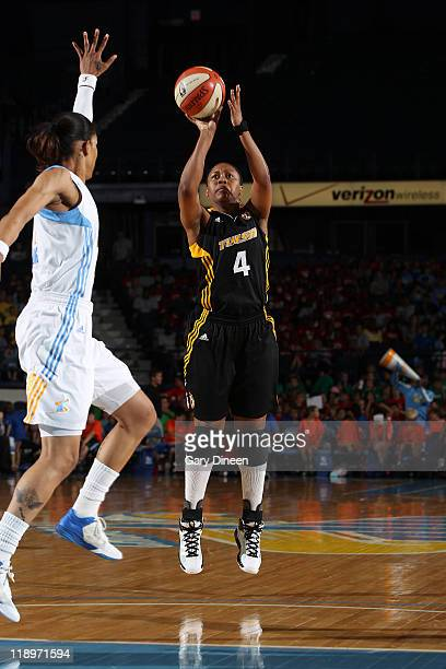 Amber Holt of the Tulsa Shock puts up a shot over Tamera Young of the Chicago Sky during the WNBA game on July 13 2011 at the AllState Arena in...
