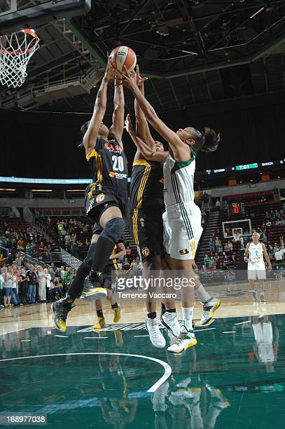 Amber Holt of the Tulsa Shock rebounds against Tina Thompson of the Seattle storm during the game on May 17 2013 at Key Arena in Seattle Washington...