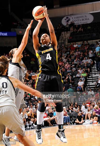 Amber Holt of the Tulsa Shock shoots against 0the San Antonio Silver Stars at the ATT Center on June 4 2011 in San Antonio Texas NOTE TO USER User...