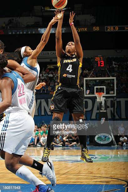 Amber Holt of the Tulsa Shock shoots the ball against Maya Moore of the Minnesota Lynx during the WNBA game on August 19 2012 at Target Center in...