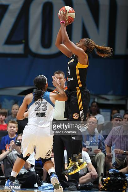 Amber Holt of the Tulsa Shock shoots the ball against Maya Moore of the Minnesota Lynx during the WNBA game on August 31 2012 at Target Center in...