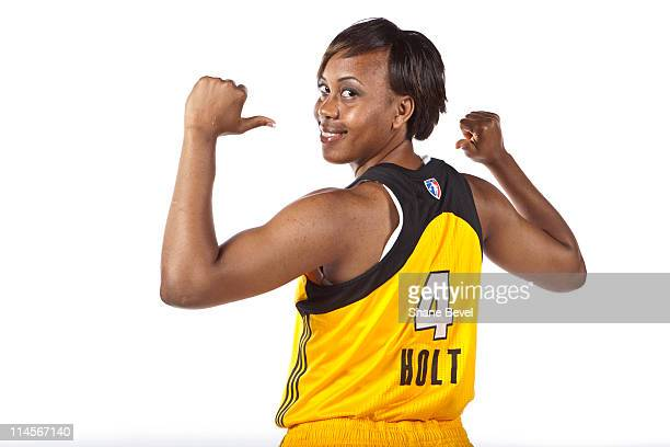 Amber Holt shows off her new jersey during the Tulsa Shock Media Day on May 23 2011 at the Shock Basketball Academy Facility in Tulsa Oklahoma NOTE...