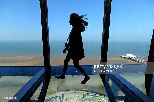 Amber Houghton a competition winner is one of the first people to walk on the new glass walkway at the top of Blackpool Tower in Blackpool northwest...