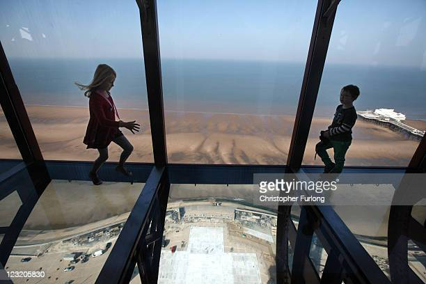 Amber Houghton aged eight tries out the new glass Skywalk at the top of the refurbished Blackpool Tower on September 1 2011 in Blackpool England...