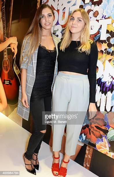 Amber Le Bon and Becky Tong attend Vogue Fashion's Night Out London 2014 at Topshop Oxford Street on September 23 2014 in London England