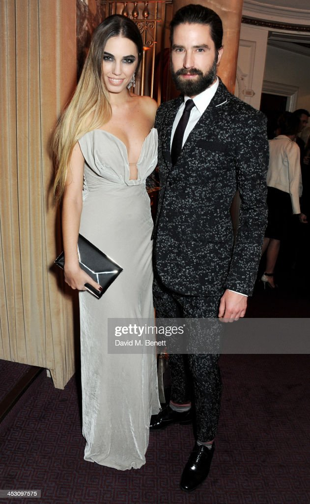 <a gi-track='captionPersonalityLinkClicked' href=/galleries/search?phrase=Amber+Le+Bon&family=editorial&specificpeople=1103030 ng-click='$event.stopPropagation()'>Amber Le Bon</a> (L) and Jack Guinness attend the British Fashion Awards 2013 drinks reception at the London Coliseum on December 2, 2013 in London, England.