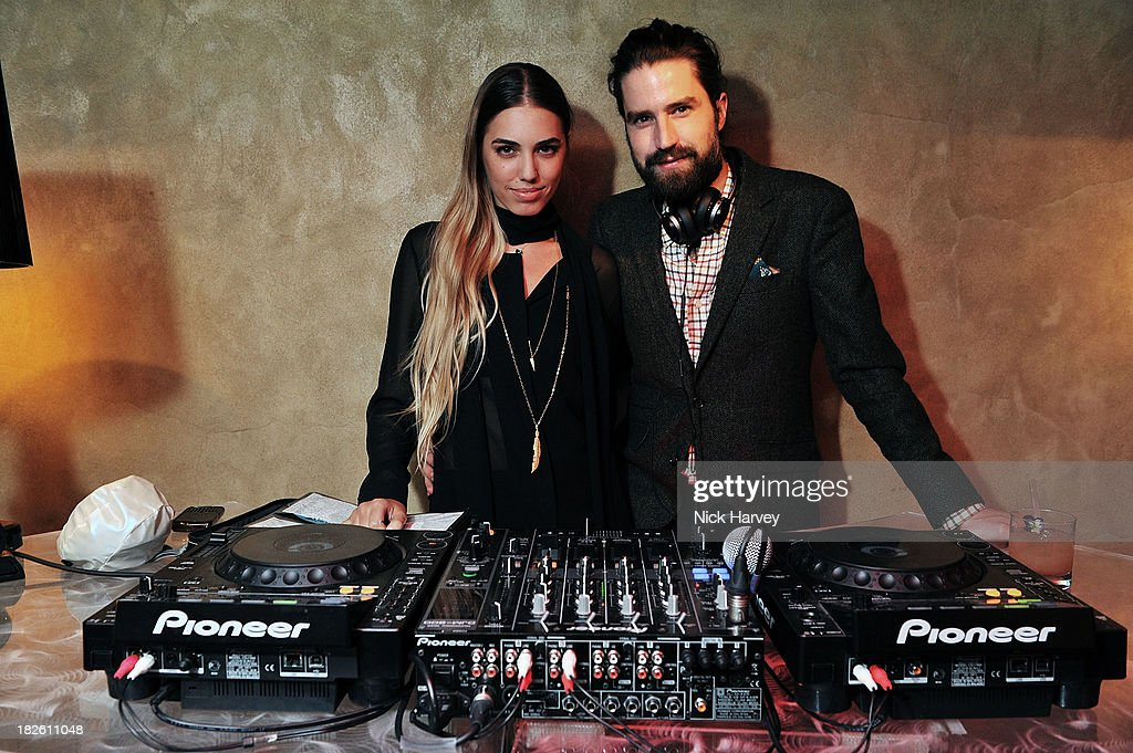 <a gi-track='captionPersonalityLinkClicked' href=/galleries/search?phrase=Amber+Le+Bon&family=editorial&specificpeople=1103030 ng-click='$event.stopPropagation()'>Amber Le Bon</a> and Jack Guinness attends Baku Cellar 164 for an exclusive show by Gavin Turk, in collaboration with A Space for Art and Baku Magazine in support of The House of Fairytales on October 1, 2013 in London, England.