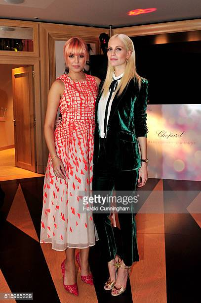 Amber Le Bon and Poppy Delevingne attend Chopard's Happy Diamonds cocktail during Baselworld on March 16 2016 in Basel Switzerland