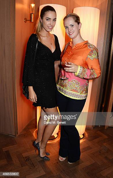 Amber Le Bon and sister Saffron le Bon attend the opening party of The Club at Hotel Cafe Royal on October 2 2014 in London England