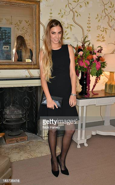 Amber Le Bon attends a dinner for L'Agent by Agent Provocateur and Net A Porter at Sibyl Colefax John Fowler on October 9 2013 in London England