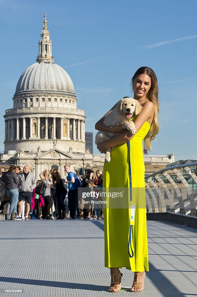Amber Le Bon attends a photocall to launch Guide Dogs Week 2013 at The Millenium Bridge on October 6, 2013 in London, England.
