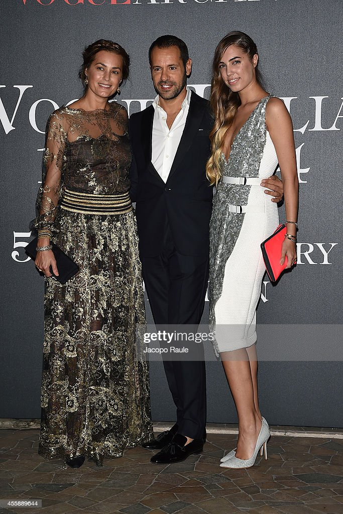 Amber Le Bon, designer Massimiliano Giornetti and Yasmin Le Bon attend Vogue Italia 50th Anniversary during Milan Fashion Week Womenswear Spring/Summer 2015 on September 21, 2014 in Milan, Italy.