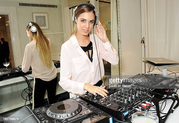 Amber Le Bon DJ's at a drinks reception celebrating the opening of Club Monaco's first London store in Westbourne Grove on October 24 2013 in London...
