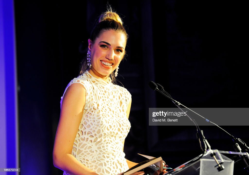 Amber Le Bon presents the Catrice Womenswear Designer award onstage at The WGSN Global Fashion Awards at the Victoria & Albert Museum on October 30, 2013 in London, England.