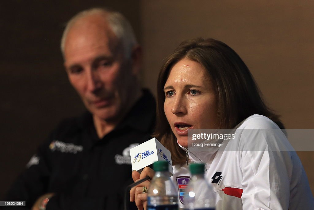 Amber Neben who will ride in the Women's Time Trial Race prior to Stage Six addresses the media during the kick off press conference for the 2013 AMGEN Tour of California on May 10, 2013 in Escondido, United States. Phil Liggett (L) NBC Sports commentator looks on.