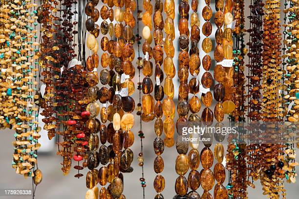 Amber necklaces for sale at market stand