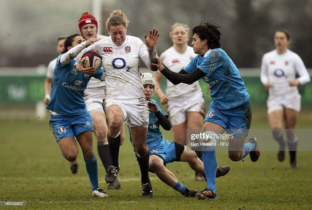 Amber Reed of England looks to break through the Italian defence during the Women's RBS Six Nations match between England and Italy at Esher Rugby Club on March 09, 2013 in Esher, England.
