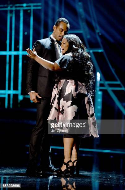 Amber Riley and Joe Aaron Reid perform on stage during The Olivier Awards 2017 at Royal Albert Hall on April 9 2017 in London England