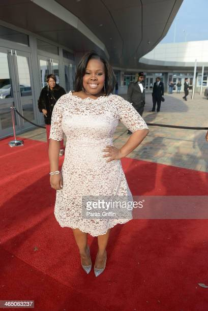Amber Riley arrives at the 2014 Trumpet Awards at Cobb Energy Performing Arts Center on January 25 2014 in Atlanta Georgia