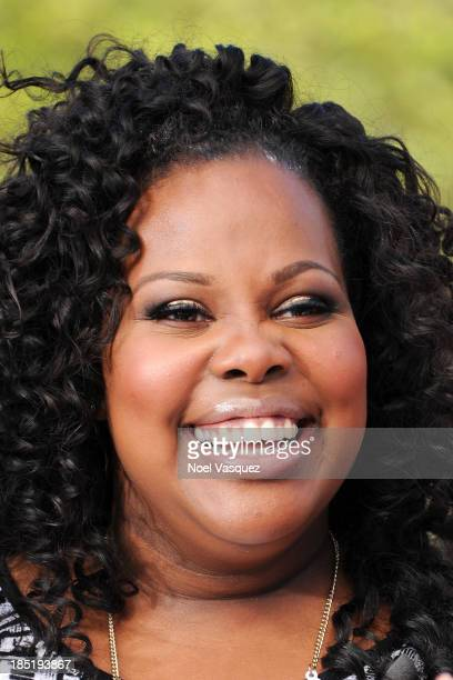 Amber Riley visits 'Extra' at Universal Studios Hollywood on October 17 2013 in Universal City California