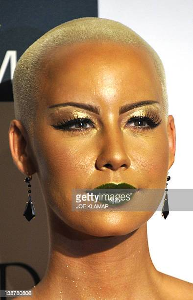 Amber Rose poses upon arrival at the Clive Davis And The Recording Academy's 2012 PreGrammy Gala And Salute To Industry Icons at the Beverly Hilton...