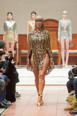 Amber Rose walks the runway at the Laurel DeWitt show during MercedesBenz Fashion Week Fall 2015 at Church of the Holy Apostles on February 15 2015...