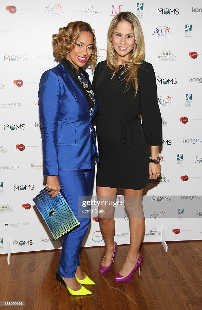 Amber Sabathia and Traci Lynn Johnson attends an evening celebrating the expansion of healthcare services to women worldwide on November 14, 2013 in New York City.