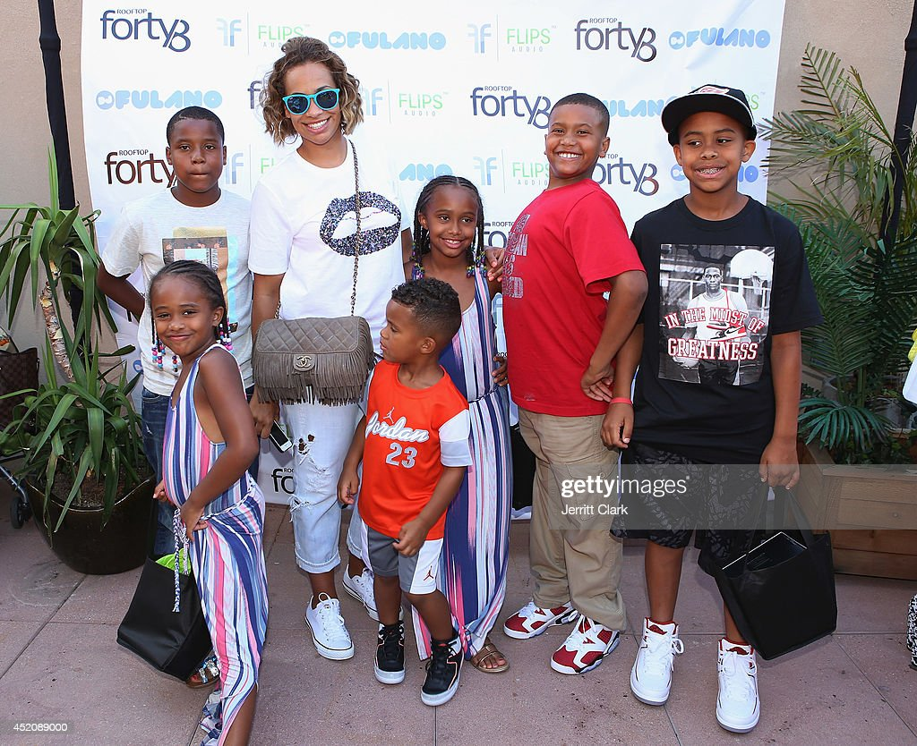 <a gi-track='captionPersonalityLinkClicked' href=/galleries/search?phrase=Amber+Sabathia&family=editorial&specificpeople=2361805 ng-click='$event.stopPropagation()'>Amber Sabathia</a> poses with her kids and friends at DJ Fulano's 11th birthday party at Rooftop 48 on July 12, 2014 in New York City.