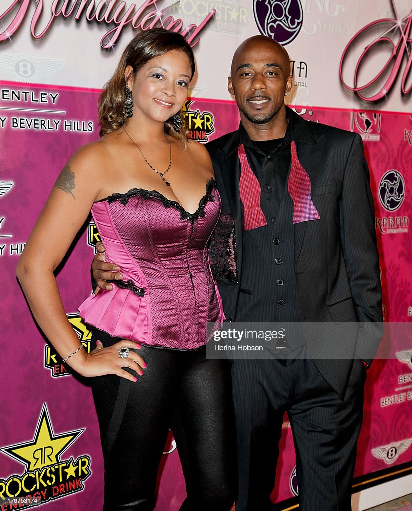 Amber Serrano and Ralph Tresvant attends the 8th annual Kandyland on August 17, 2013 in Beverly Hills, California.