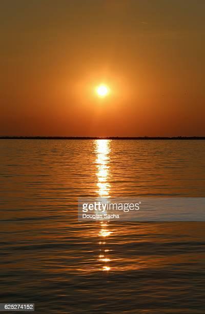 Amber sun filed Sky over the lake