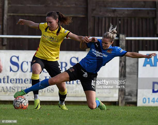 Amber Tullett of Watford Ladies is tackled by Emma Lipman of Sheffield FC Ladies during the FA WSL 2 match between Watord Ladies and Sheffield FC...