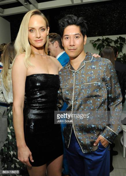 Amber Valletta and Carlos Lopez attend THE OUTNET x Amber Valletta at Waldorf Astoria Beverly Hills on October 19 2017 in Beverly Hills California