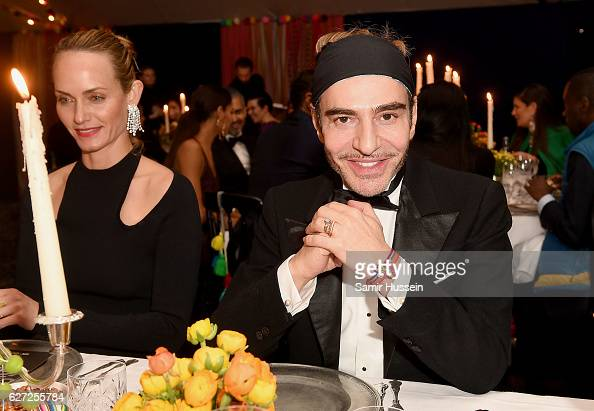 Amber Valletta and John Galliano attend the gala dinner as The Business of Fashion Presents VOICES on December 2 2016 in Oxfordshire England