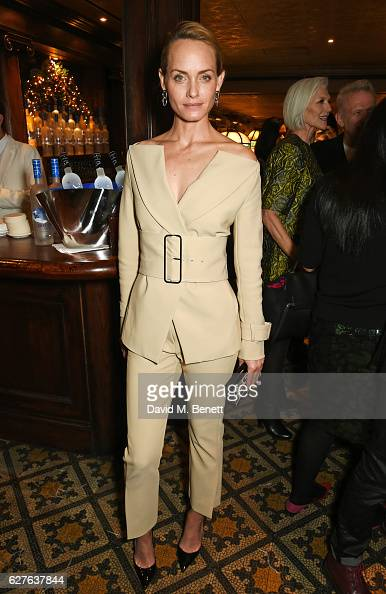 Amber Valletta attends The Fashion Awards in partnership with Swarovski nominees' lunch hosted by the British Fashion Council with Grey Goose at...