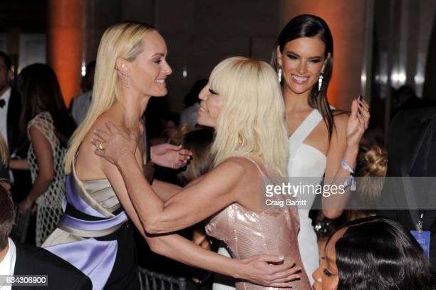 Amber Valletta Donatella Versace and Alessandra Ambrosio attends the amfAR New York Gala 2017 sponsored by FIJI Water at Cipriani Wall Street on...