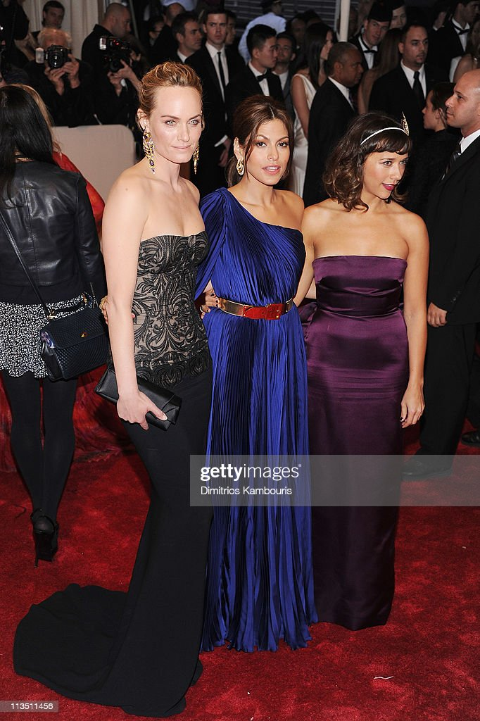 Amber Valletta, Eva Mendes and Rashida Jones attend the 'Alexander McQueen: Savage Beauty' Costume Institute Gala at The Metropolitan Museum of Art on May 2, 2011 in New York City.