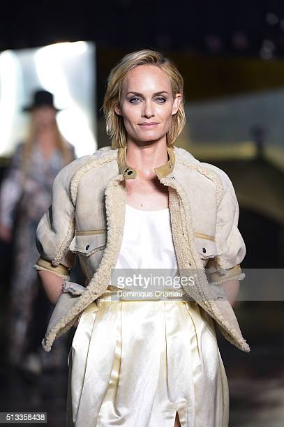 Amber Valletta walks the runway during the HM show as part of the Paris Fashion Week Womenswear Fall/Winter 2016/2017 on March 2 2016 in Paris France