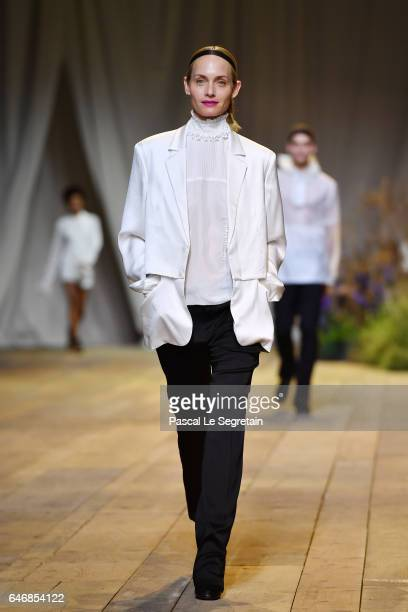 Amber Valletta walks the runway during the HM Studio show as part of the Paris Fashion Week on March 1 2017 in Paris France