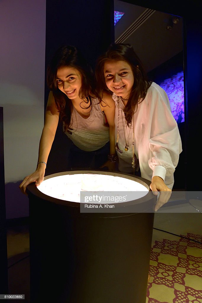 Ambika Hinduja Macker (L), Conscious Space Designer poses with her sister, Satya Hinduja, the Sound Artist (Composer, Producer & DJ at Tabula Rasha Music) during Hanami, an immersive art show she curated for Indian photographer and visual artist Rohan Shrestha at the Diesel Store on February 13, 2016 in Mumbai, India.
