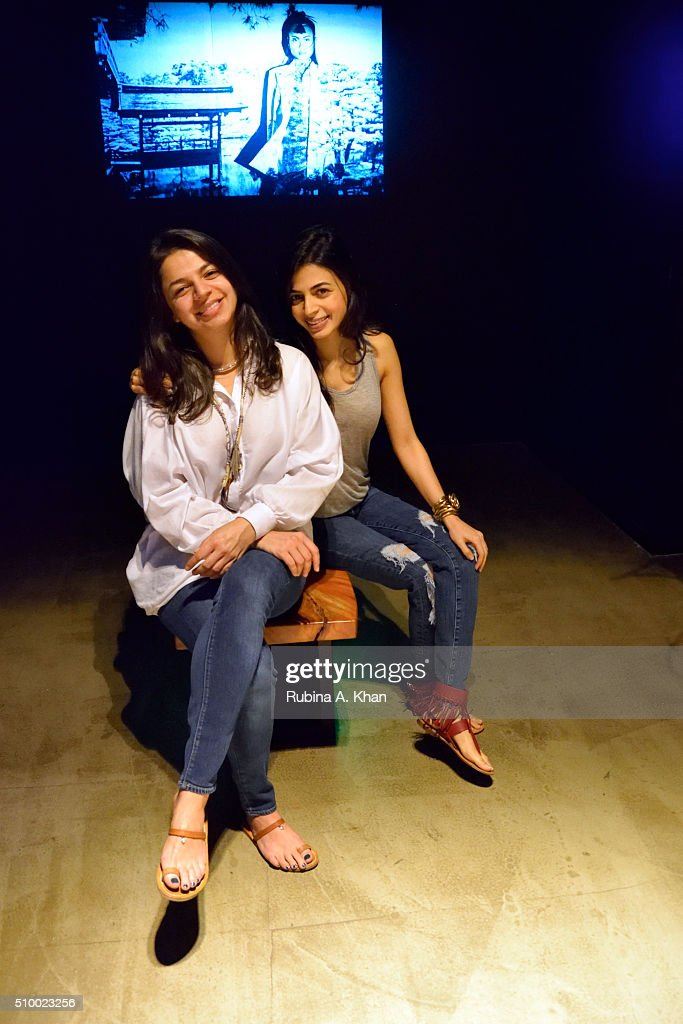 Ambika Hinduja Macker (R), Conscious Space Designer poses with her sister, Satya Hinduja, the Sound Artist (Composer, Producer & DJ at Tabula Rasha Music) during Hanami, an immersive art show she curated for Indian photographer and visual artist Rohan Shrestha at the Diesel Store on February 13, 2016 in Mumbai, India.