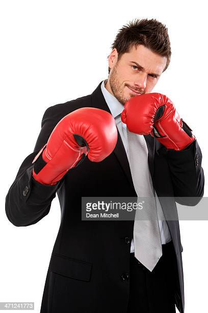 Ambitious businessman checking the competition isolated on a white background