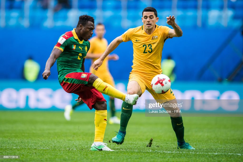 Ambroise Oyongo (L) of Cameroon and Tommy Rogic (R) of Australia fight for the ball during the FIFA Confederations Cup Russia 2017 Group B match between Cameroon and Australia at Saint Petersburg Stadium on June 22, 2017 in Saint Petersburg, Russia.