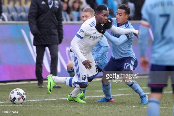 Ambroise Oyongo of Montreal Impact is challenged by Jonathan Lewis of New York City FC during the New York City FC Vs Montreal Impact regular season...