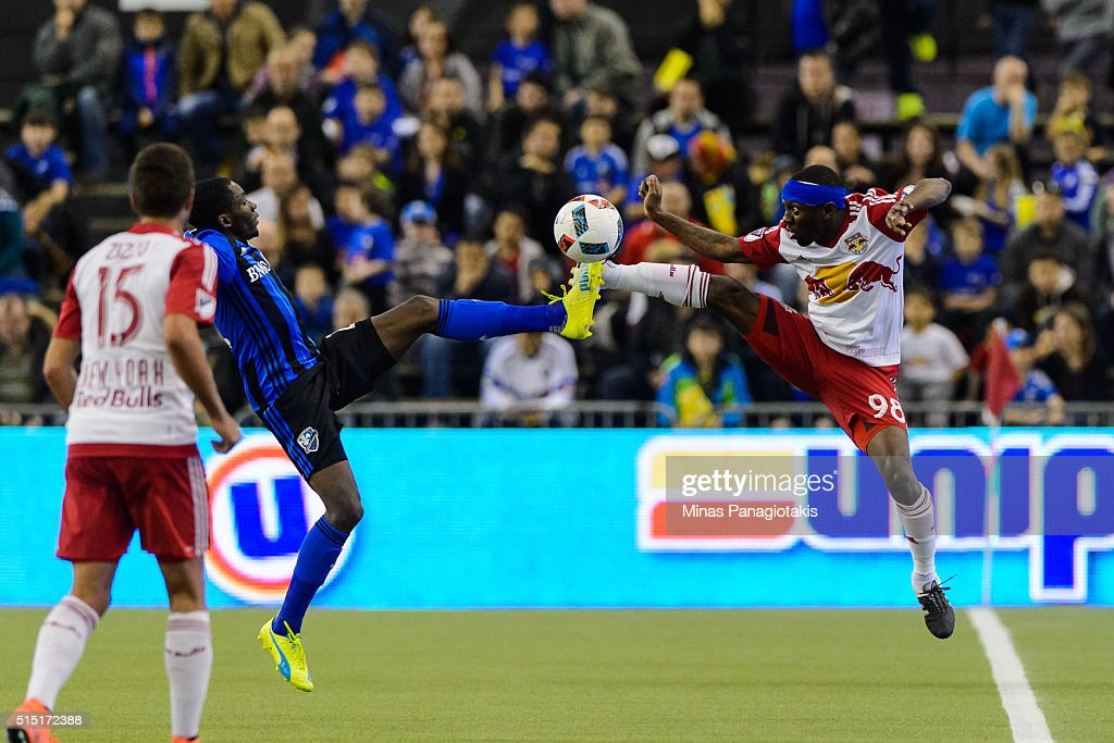 Ambroise Oyongo #2 of the Montreal Impact and Shaun Wright-Phillips #98 of the New York Red Bulls kick the ball during the MLS game at the Olympic Stadium on March 12, 2016 in Montreal, Quebec, Canada. The Montreal Impact defeated the New York Red Bulls 3-0.