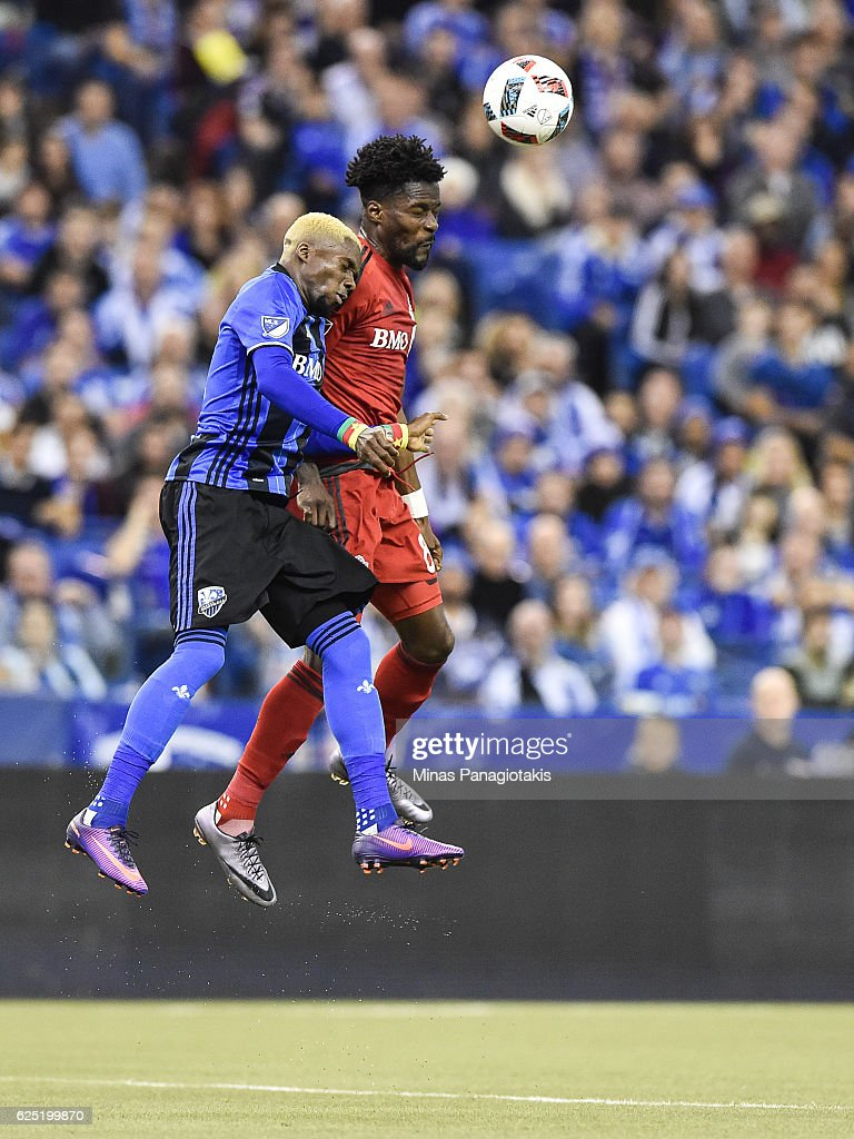 Ambroise Oyongo #2 of the Montreal Impact and Tosaint Ricketts of the Toronto FC jump for the ball during leg one of the MLS Eastern Conference finals at Olympic Stadium on November 22, 2016 in Montreal, Quebec, Canada. The Montreal Impact defeated the Toronto FC