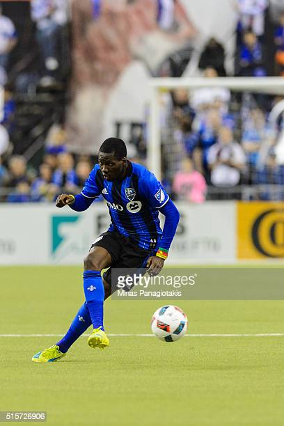 Ambroise Oyongo of the Montreal Impact plays the ball during the MLS game against the New York Red Bulls at the Olympic Stadium on March 12 2016 in...