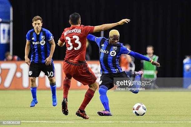 Ambroise Oyongo of the Montreal Impact prepares to kick the ball in front of Steven Beitashour of the Toronto FC during leg one of the MLS Eastern...