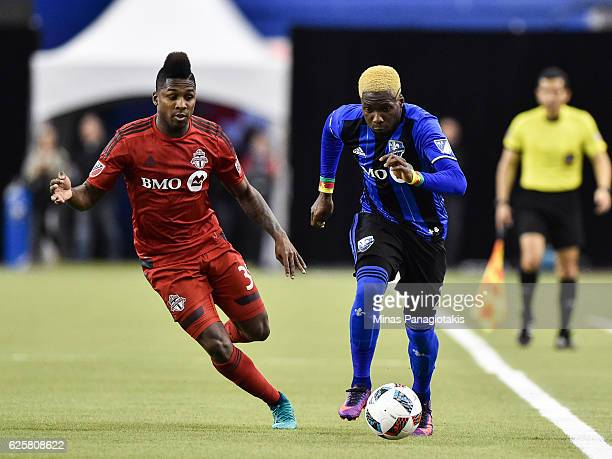 Ambroise Oyongo of the Montreal Impact runs with the ball against Armando Cooper of the Toronto FC during leg one of the MLS Eastern Conference...