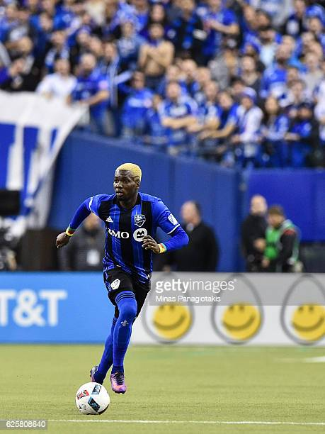 Ambroise Oyongo of the Montreal Impact runs with the ball during leg one of the MLS Eastern Conference finals against the Toronto FC at Olympic...