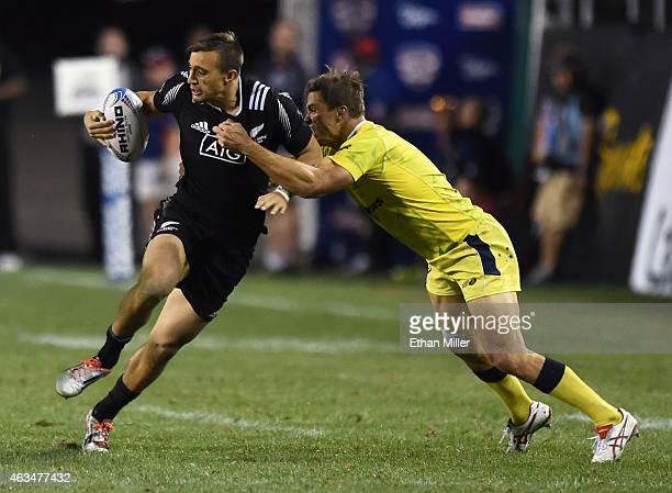 Ambrose Curtis of New Zealand is tackled by Ed Jenkins of Australia during the USA Sevens Rugby tournament at Sam Boyd Stadium on February 14 2015 in...
